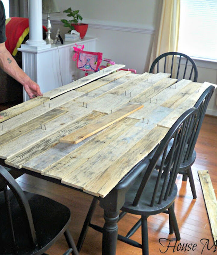 Once he had enough he started to lay them out on the table for placement and size.  I also didn't want everything to match up [again I like rustic] and when you have three boys in the house--my two step son's and my eight year old brother who visits often and a two year old little girl who is more destructive then her older brothers - rustic is great! Because when it does get nicked here and there it looks like it was supposed to be that way. Tricks of a mother ;-)