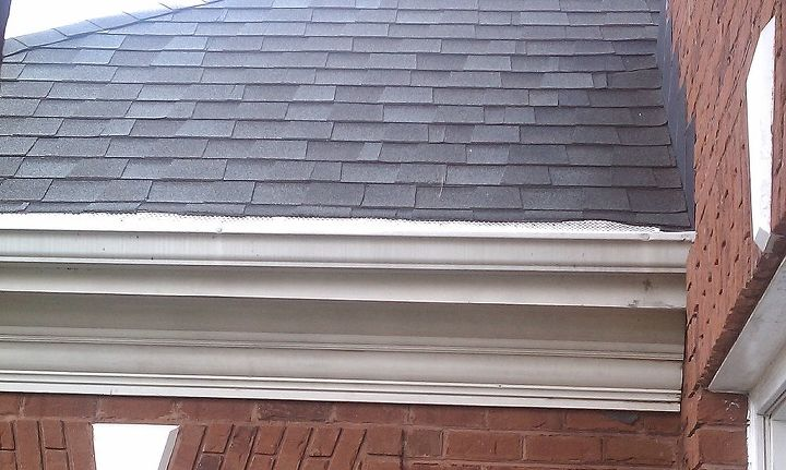 Gutters with Gutter guards for leaves/debris, SHingles USED to overhang the gutters and water ran past the gutters down to the ground.