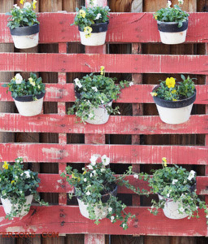 An old Wood Pallet and Terra Cotta pots make an instantly gorgeous hanging garden.  Just add flowers!  http://www.redouxinteriors.com/2012/03/redoux-is-in-country-living-magazine/