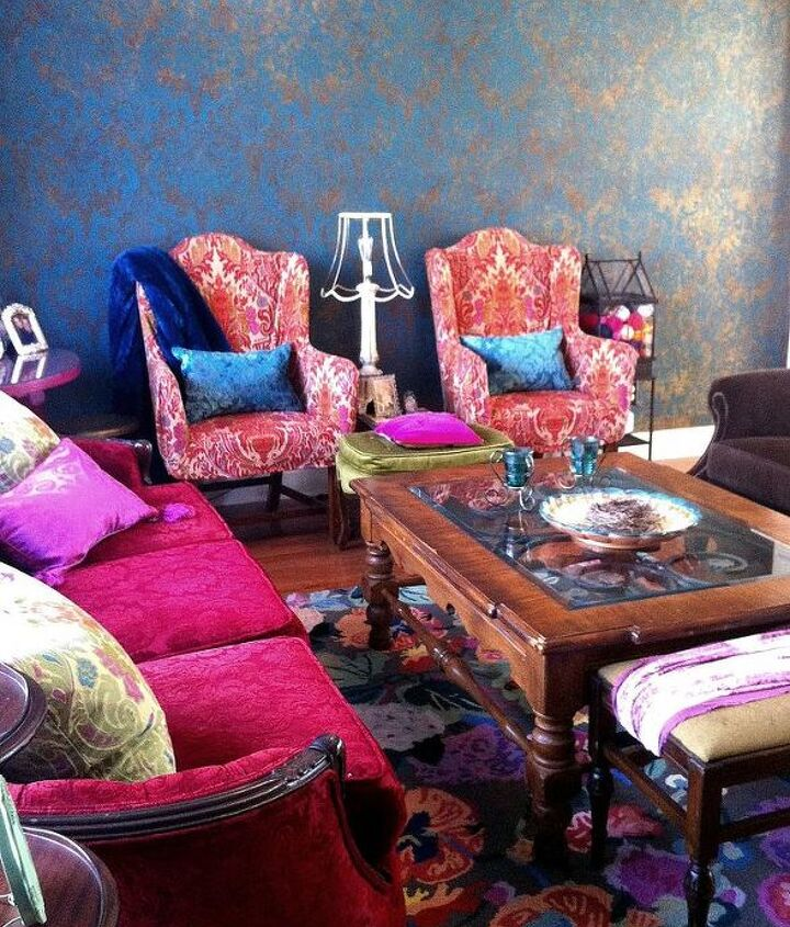 Stenciled wall treatment with slipcovered chairs, hand-me-down coffee table and craigslist couch.