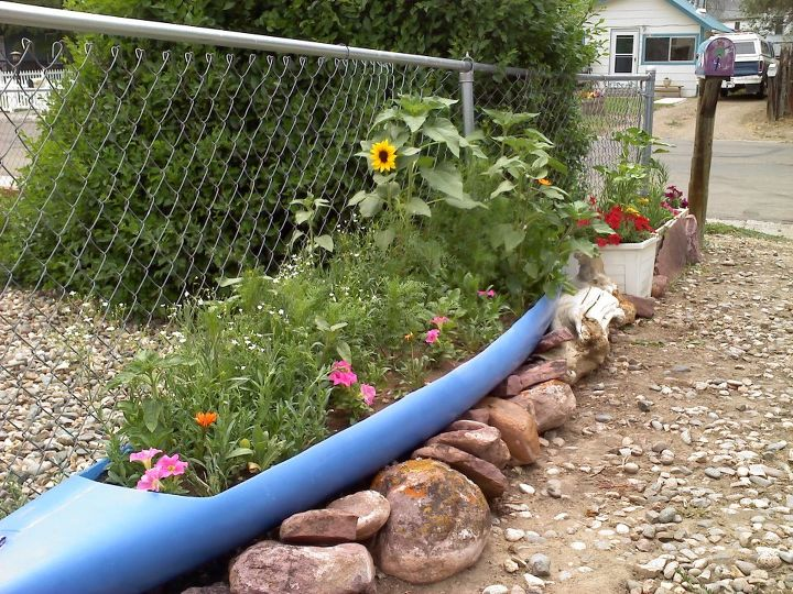 another of the husband s creative ideas, gardening, repurposing upcycling, Kayak Planter 1 1 2 months old