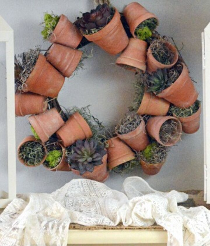 This sweet flower pot wreath is nestled in a little nook in my kitchen that doesn't get much natural light- so faux succulents are perfect here!