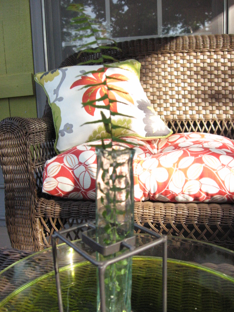 Cushions and pillows are put away in a deck box to keep them out of the weather.