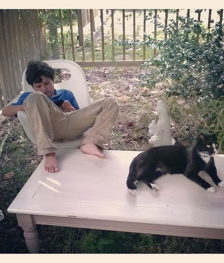 My son and the Cat getting the table ready for me