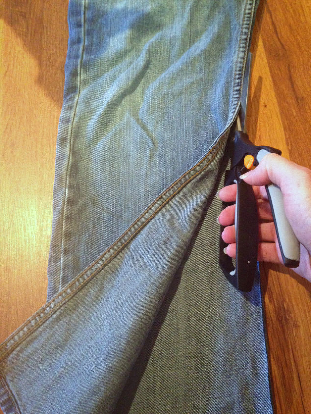 """Using an old pair of jeans, cut up the side hems of each leg about 24""""."""