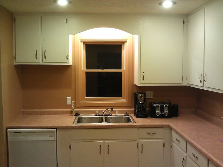 We opted to paint the trim around the windows to match the wall for two reasons: There just wasn't enough space between it and the cabinets to have it be white, and the trim around the two windows was different on each (new vs old).