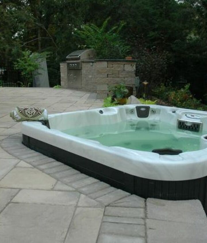 Hot Tub Patio: A hot tub can be set into a patio for a built-in look while allowing the hot tub's plumbing to be easily accessible.