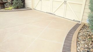 q help with decorating patio and have privacy, decks, outdoor living, patio, This driveway wash just a mere boring concrete just like your We stained it seal and engraved it to look like brown brick borders pattern and tiles in the middle This is done on the existing concrete like yours