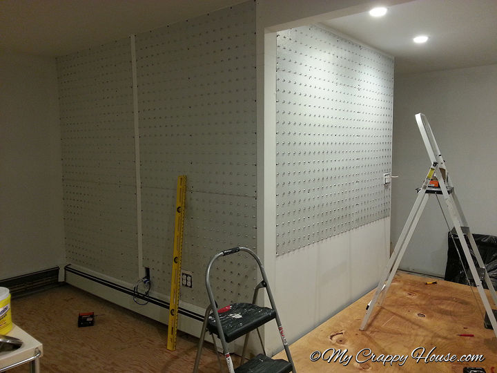 The process involves screwing special sheet metal panels to the wall, then affixing the brick.