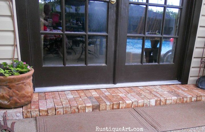 recycled fireplace brick into patio step landing, concrete masonry, curb appeal, fireplaces mantels, patio, the new brick step landing outside our patio doors added dimension color and a nice upscale finished look