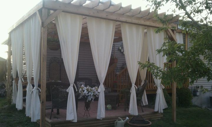 My husband built this Pergola for me last summer...complete with a misting system... He appears to be a professional builder, but in fact he's an Airforce parachute rigger :)