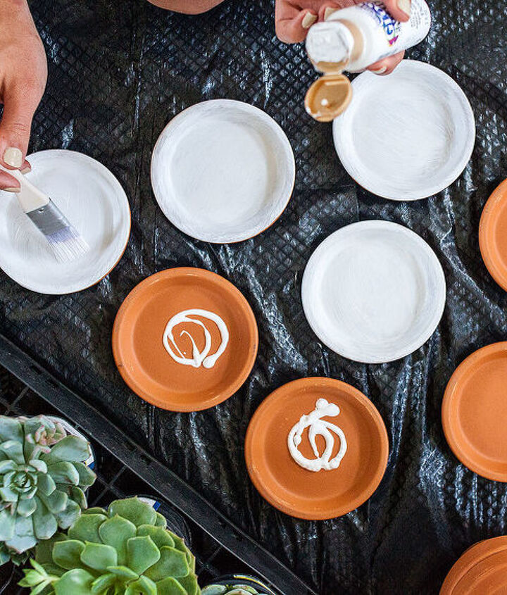Painting the terra cotta pots + plates is a total cinch. I did 18 pieces in under an hour!