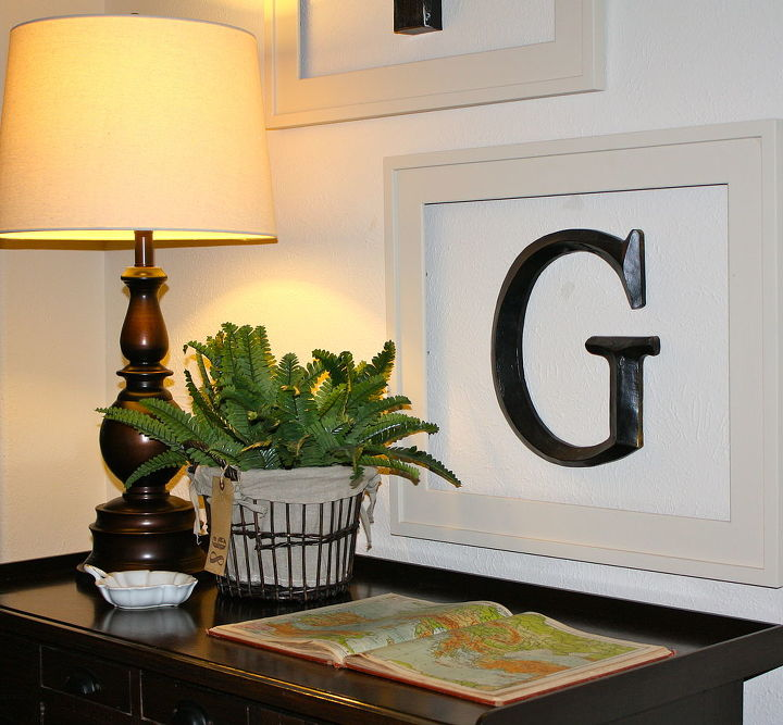Our entry table that leads into the living room...it's an old watchmakers table ; o )