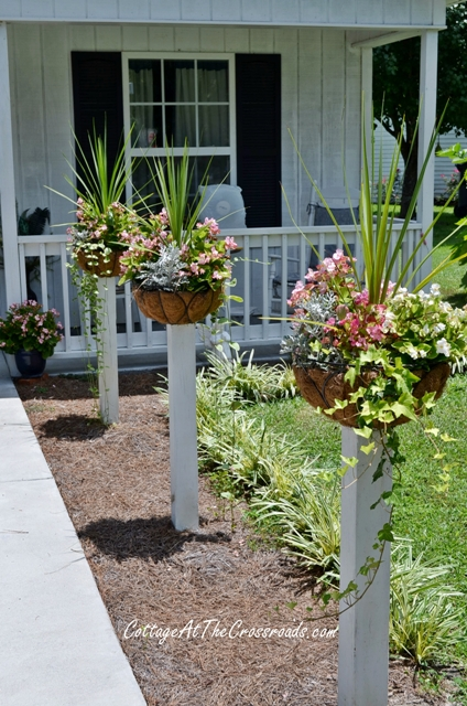 how to mount flower baskets onto wooden posts, curb appeal, diy, flowers, gardening, how to, repurposing upcycling, woodworking projects, The flower baskets are mounted onto treated wood 4x4 s