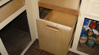 q any ideas for replacing our vinyl laminate contractor grade kitchen, flooring, kitchen design, tile flooring, This is the corner under the window this pull out unit they built to exact specs and it s wild I call it my kitchen toy box LOL