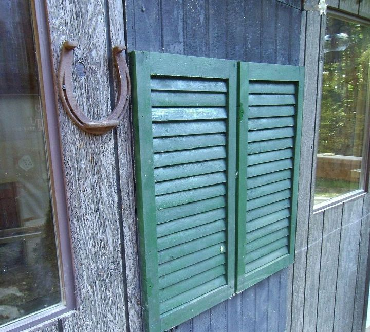 We took an old shutter, cut it in half and attached it to an old door, to give the appearance of swinging saloon doors.