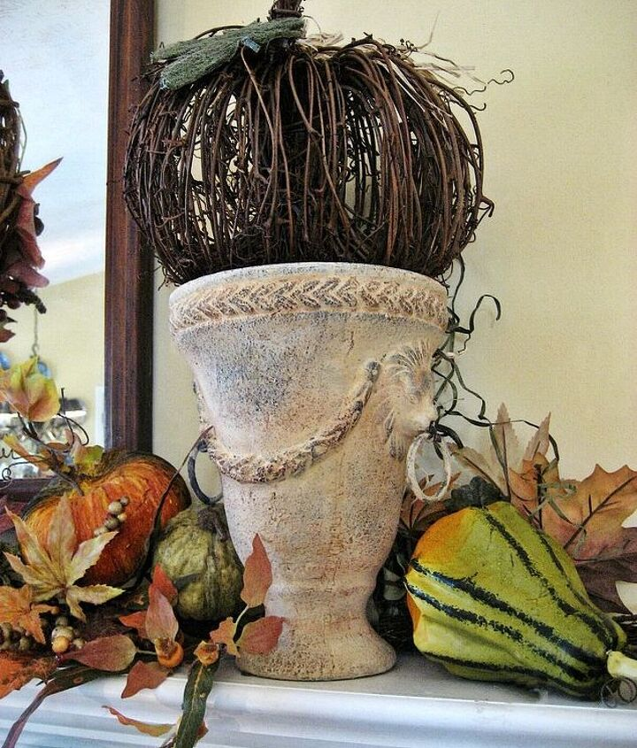 Twine pumpkins add texture to my frenchy lion's head urns. Love the muted colors!