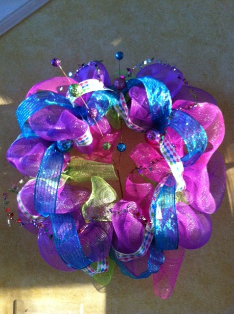 1st Wreath I made.  I used a bigger straw wreath.  This wreath comes out really big.  I think I like using the smaller wreath.