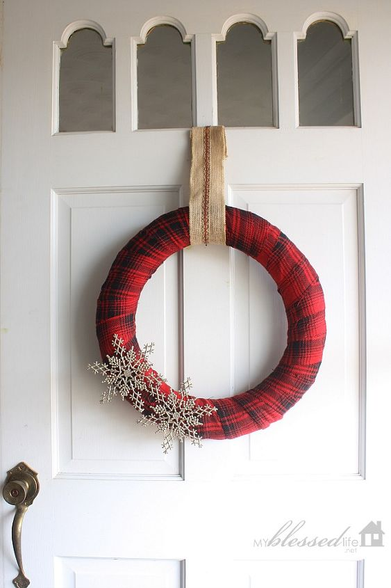This is the front door wreath that I made with a thrift store skirt and two gold snowflakes. SO easy!