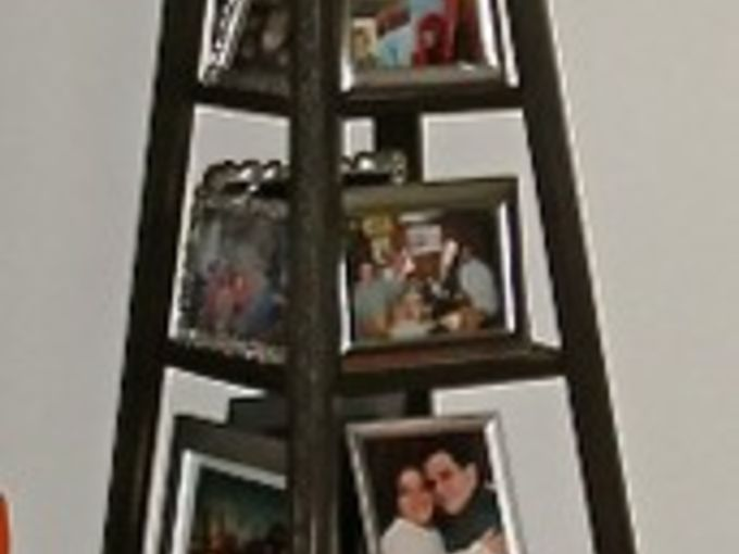 lazy susan photo tower, diy, home decor, woodworking projects, Lazy Susan Photo Tower I made to corral family photos The base has a lazy susan built into it so the entire tower turns The frames are all silver with black felt backs