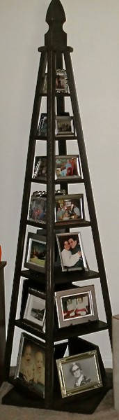 Lazy Susan Photo Tower I made to corral family photos.  The base has a lazy susan built into it, so the entire tower turns.  The frames are all silver with black felt backs.