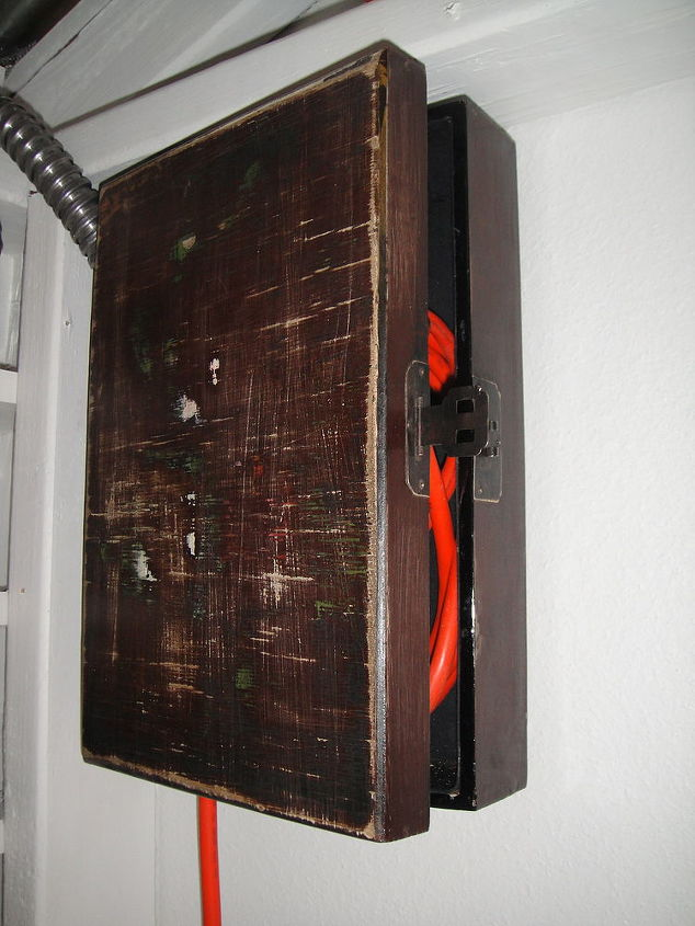 """The """"electrical"""" box.  I used an extension cord for electricity to the workshop.  An old silverware box was hung to hide the cord."""