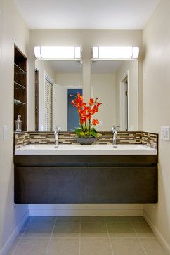 Attach the vanity to the wall to save space and make cleaning under the floor easier.