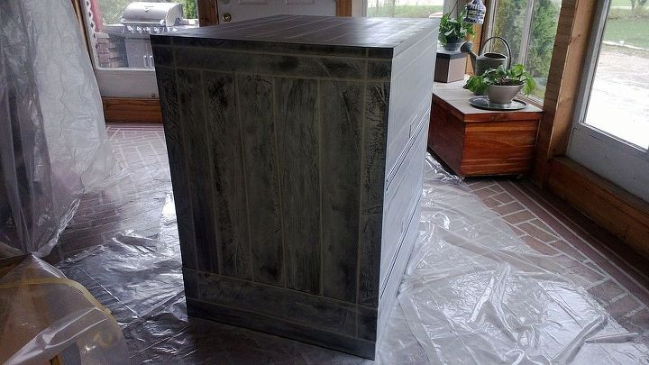 This is going around the cabinet, spraying, putting on the cloth and making the textured imprint.