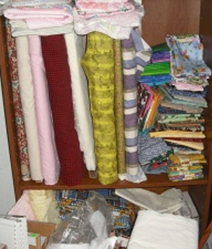 Again, more of my fabric....look how bulky right???? Here is a site to explain how to fold material and use the boards http://www.quiltingboard.com/tutorials-f10/alaskasunshines-fabric-folding-organizing-your-quilt-room-t43871.html