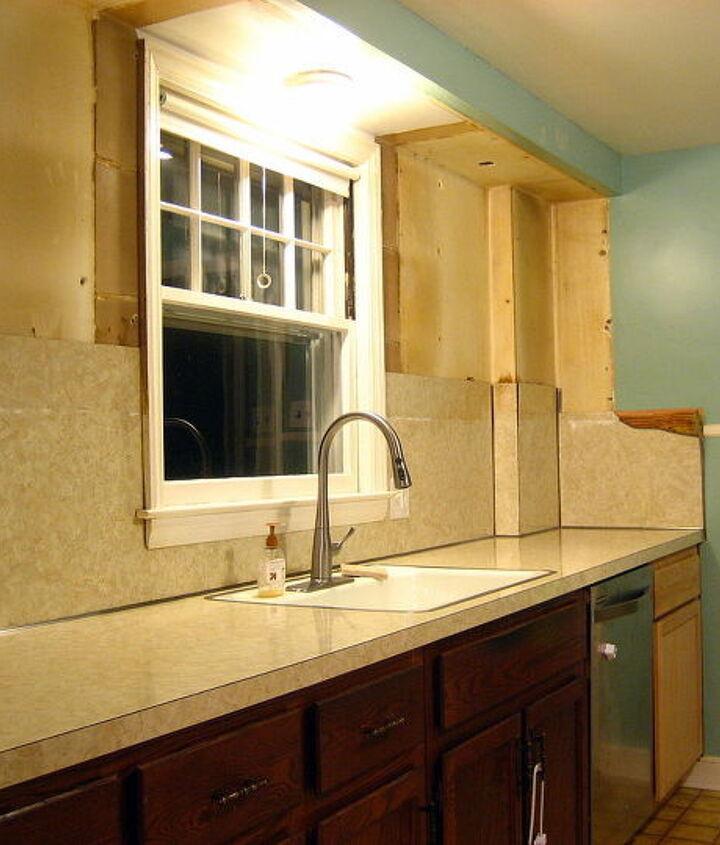 Cabinets gone, laminate backsplash is next!