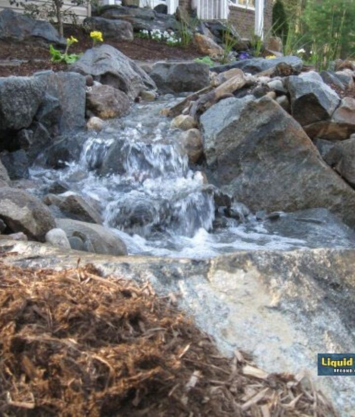 The last waterfall from the stream before cascading over the final 1500lb boulder which dissapears into the 600 gallon below grade reservoir.