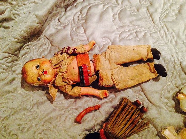 q how do you care for old dolls parts clothes, crafts, This is what he should look like