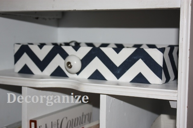Faux drawer covered in fabric.