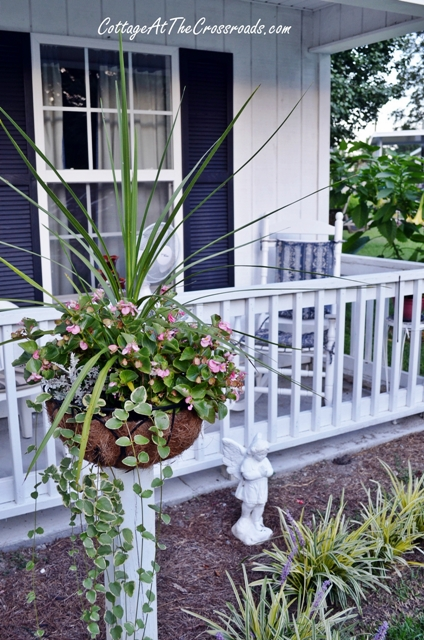 how to mount flower baskets onto wooden posts, curb appeal, diy, flowers, gardening, how to, repurposing upcycling, woodworking projects, The flowers are at a height that my mother can enjoy them while she s sitting on her front porch
