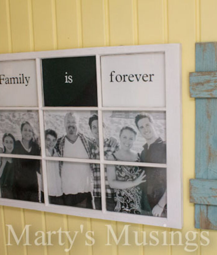 Old window frame and fence boards turned into Family Photo Display