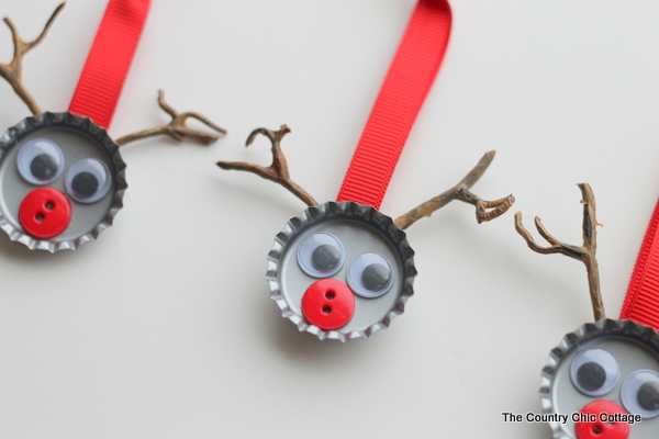 Recycle your botle caps and hang them on the tree.  http://www.thecountrychiccottage.net/2012/12/bottle-cap-reindeer-kids-craft.html?m=1