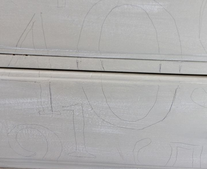 Print out the numbers and trace onto the drawer fronts with graphite paper.