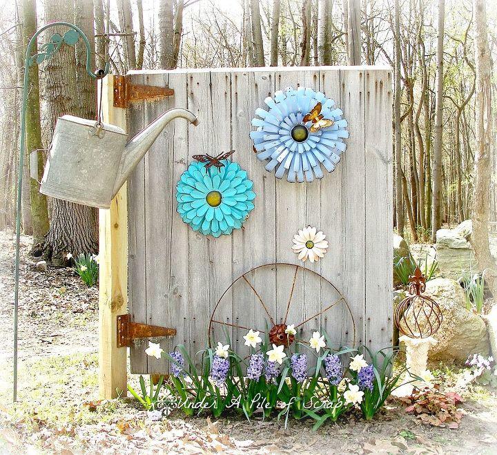 Barn door made into garden art.