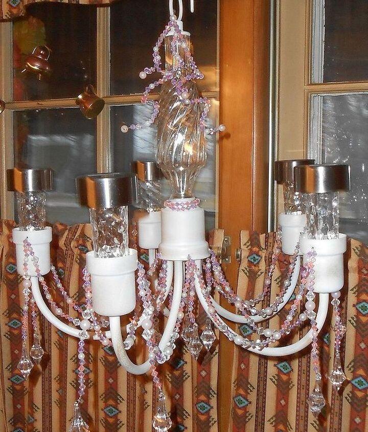 An old light fixture into a garden chandelier.