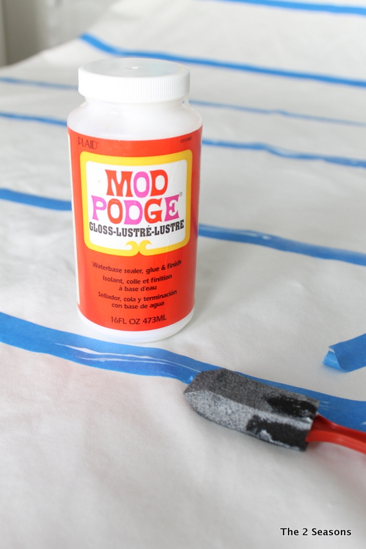 I painted Mod Podge along the edges of the tape to seal the edges and keep the paint from getting under the tape.