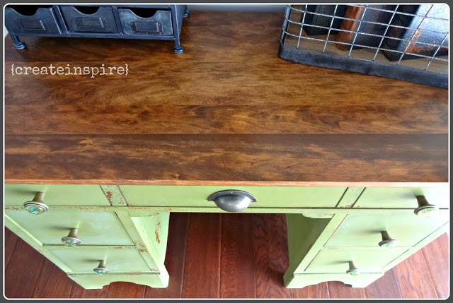 The first thing I always do is decide if the top can be restored.  So many of these pieces have such lovely wood and in this case very unique.  I loved the grain so sanded it all down, stained it, and gave it a few coats of poly.