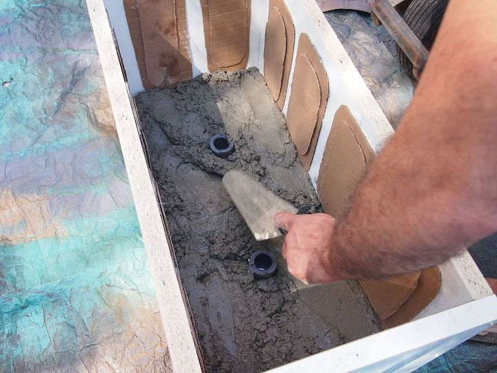 Fill the bottom of the outer box with concrete. We used some tubing for drain holes.