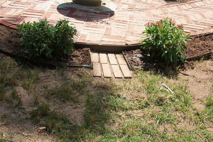Set up two step-downs for yard access between the beds. One width of brick wasn't long enough.
