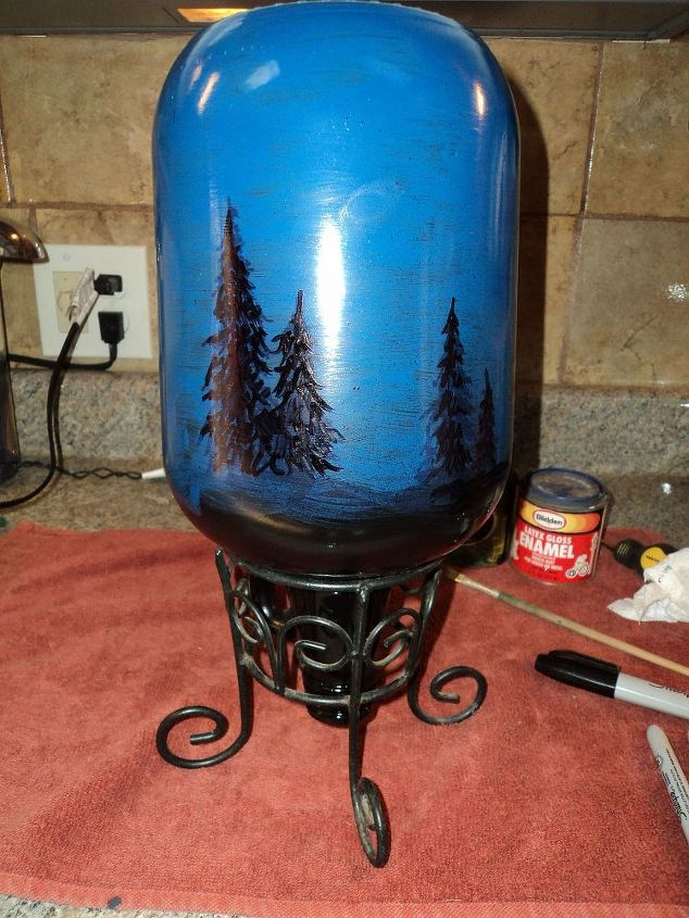 starry night light, christmas decorations, crafts, lighting, seasonal holiday decor, 3 Place bottle into the planter holder Using a black Sharpie pen draw in trees all the way around the bottle