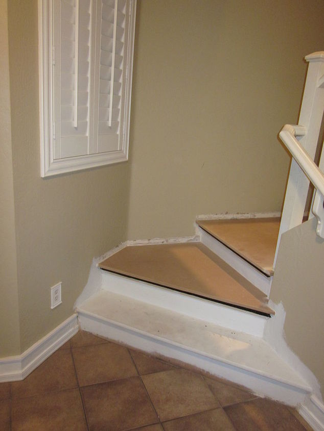 Replace the landing with new MDF to hide the particle board landing that was installed by the builders
