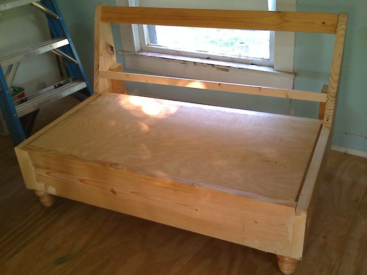 I built the bench frame with 2x4's and plywood and added turned feet for a little western elegance