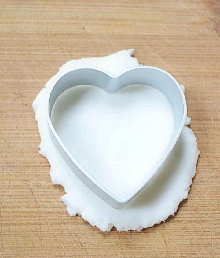 Step 1: After mixture cools, start having fun playing with the clay! Use a heart shaped cookie cutter to cut out your hearts.