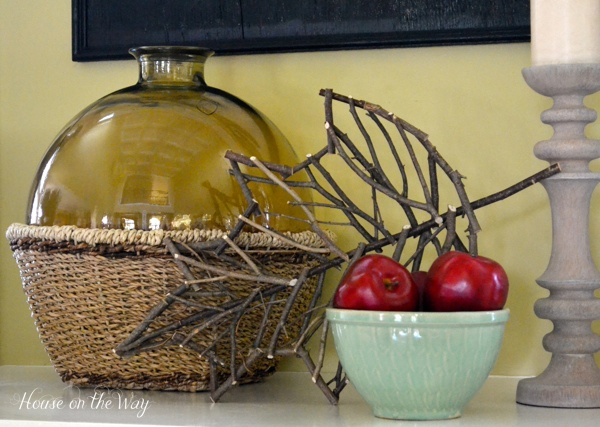 My Fall mantel this year is simple with natural elements and a pop of color from the bowl of red apples.