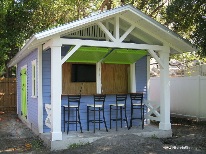 Custom snack bar with awning shutter open to bar area with TV