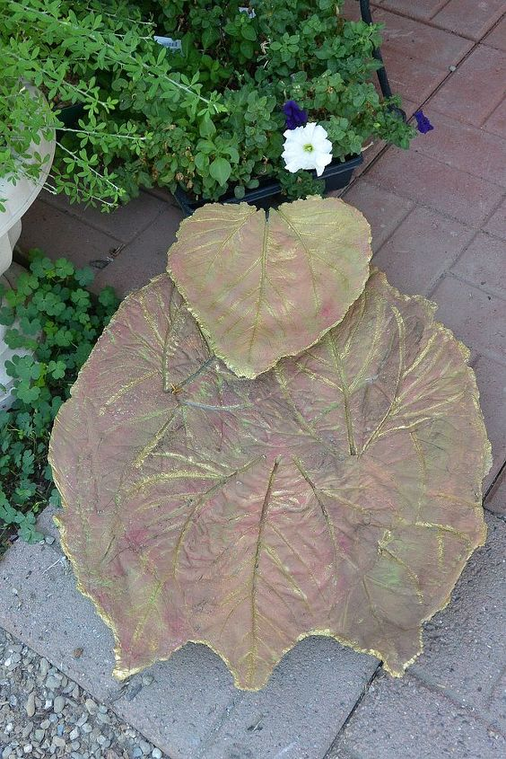 My cement leaves I'm going to make into a little fountain. The large one is made from several sunflower leaves.